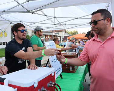Sean Guesman serves a beer sample at the Butler Area Society of Homebrewers tent at Mars Brew Fest Saturday. Seb Foltz/Butler Eagle 09/18/21