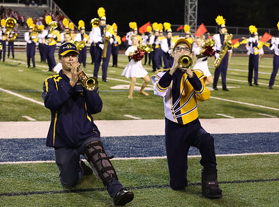 Nursing injuries, Alecx Colins (left) and Blake Bernosky still performed with their Goldent Tornado Marching Band mates at the Butler County Band Festival Wednesday Sept. 29. Seb Foltz/Butler Eagle 09/29/21