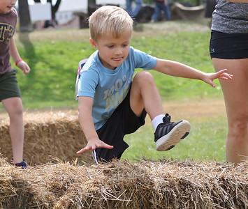 Eli Stewart, 4, clears a hay bail in Saturday's Tuff Tornado Run at Alemeda Park. Seb Foltz/Butler Eagle 10/02/21