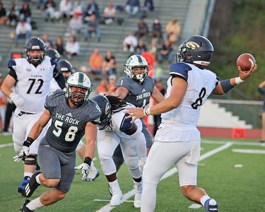 Slippery Rock defensive lineman Matt Wilwohl pressures Clarion quarterback Taylor Eggers in Saturday's home win. Seb Foltz/Butler Eagle 10/02/21