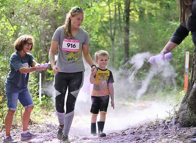 Tanya Riley and her son Tristan Riley, 4, walk through the color run obstacle in Saturday's Tuff Tornado Run at Alemeda Park. Seb Foltz/Butler Eagle 10/02/21