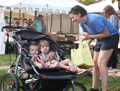 Annabelle Miller, 3, (center) and her sister Shiloh,1, have a pre-dinner cupcake  with ther mother Sarah Miller at the Prospect Community Library Fall Book & Bake Sale Thursday. Seb Foltz/Butler Eagle 10/07/21