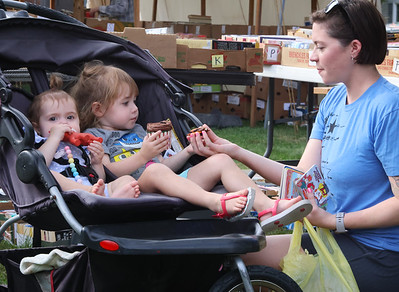 Annabelle Miller, 3, (center) and her sister Shiloh,1, have a pre-dinner cupcake  with their mother Sarah Miller at the Prospect Community Library Fall Book & Bake Sale Thursday. Seb Foltz/Butler Eagle 10/07/21