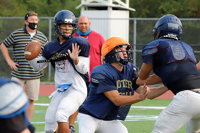 Butler running back Isaiah Kelly steps into the quarterback role running the scout team offense against Butler's varsity defense at practice Wednesday. Seb Foltz/Butler Eagle 09/16/20