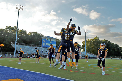 Before the Mars Area High School verses Hampton game Friday, Sept. 11, 2020. During COVID-19 restrictions, attendance at outdoor events was limited to 250. Offensive lineman Logan Vanderberghe, No. 66, and tight end Chris Dvorak, Number, 82, celebrate during player introductions at the first game of the season. SEB Foltz/Butler eagle