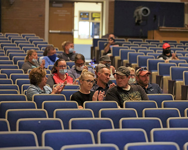 Knoch Area School District parents clap for a speaker objecting to the school's compliance with the state mask mandate at the district's school board meeting Wednesday. Around 45 parents, students and family members attended. Seb Foltz/Butler Eagle. 09/08/21