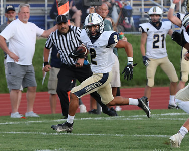 Freeport's Ben Lane breaks into open field to score the game's first touchdown at Knoch Friday. Freeport won 28-14 on the road. Seb Foltz/Butler Eagle 09/03/21