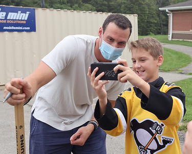 Pittsburgh Penguins defender Brian Dumoulin poses for a selfie with Knoch sixth grader Nate McCurdy, 11, Thursday during a visit to the school. Seb Foltz/Butler Eagle 09/16/21