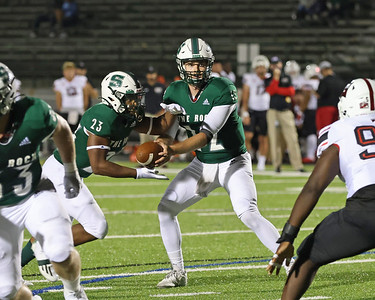 Slippery Rock quarterback Andrew Koester hands off to running back Tim Smith in SRU's 22-7 home win over East Stroudsburg Saturday. Seb Foltz/Butler Eagle 09/11/21