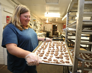 Peter's Chocolate Shoppe owner Lori Steinheiser pulls out a tray of chocolate Tuesday at her store on West Jefferson St. Seb Foltz/Butler Eagle 09/14/21