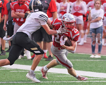 Slippery Rock's Ryan Montgomery stiff arms Grove City's Joey Hathaway in the Rockets 34-7 home win Friday. Seb Foltz/Butler Eagle 09/17/21