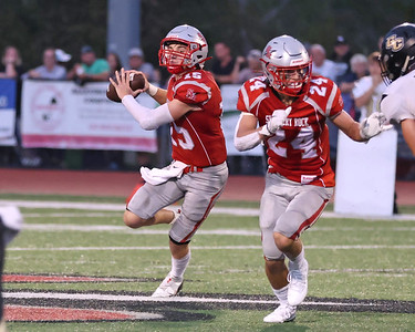 Slippery Rock's William Mokel rolls out to pass against Grove City in Friday's 37-7 home win. Seb Foltz/Butler Eagle 09/17/21