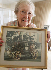 Marilyn Warrens holds up a picture that was taken during a parade that La Senoras helped put on, she's smiling and waving out the rear window June 14, 2016 at Chico High School in Chico, Calif. (Emily Bertolino -- Enterprise-Record)