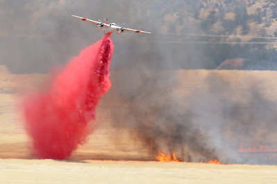 "An air tanker makes a drop as firefighters battle a wildland fire south of Neal Rd. calling it the ""99Fire"" Tuesday Aug. 2, 2016. As of 4:30 p.m. approx. 500 acres have burned and it is not contained. (Bill Husa -- Enterprise-Record)"