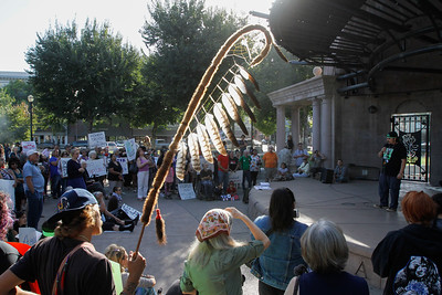 People gather in the City Plaza to protest the Dakota Access Pipeline in solidarity with the Standing Rock Sioux who say the pipeline is detrimental to their land and fear potential water contamination September 13, 2016  in Chico Calif. The Dakota Access Pipeline is a 1,172-mile, 30-inch diameter pipeline meant to transport crude oil from the Bakken and Three Forks production areas through North Dakota, South Dakota and Iowa to a processing plant in Patoka, Illinois. (Emily Bertolino -- Enterprise-Record)