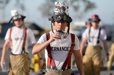 "Butte College Fire Academy student Rafael Hernandez gets a drink of water after students climbed stairs at their training facility in honor and memory of the victims and firefighters lost in the 911 tragedy 15-years-ago. Hernandez carried a photo of NYFD Firefighter Sean Patrick Tallon aka ""Charger"" on his helmet during the memorial Mon. 9-12-2016. (Bill Husa -- Enterprise-Record)"