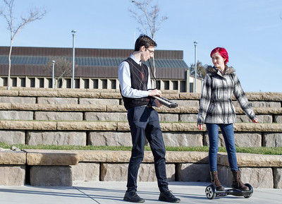 Modern day romance, Kayla Bridges rides around on a hoverboard as Spencer Hill plays his melodica Monday January 25, 2016 at Butte College in Oroville, Calif. (Emily Bertolino -- Enterprise-Record)