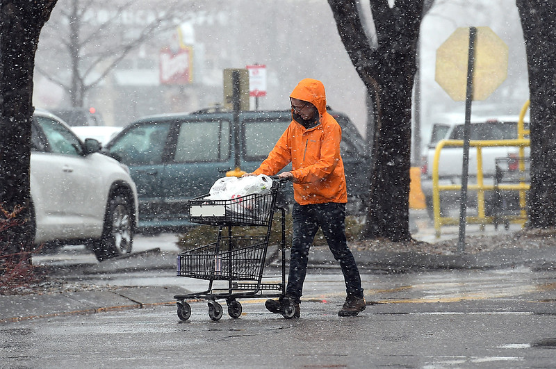 "Gary Schmidt of Loveland braces himself against the snow ans wind as he walks to his car with groceries Wednesday, March 13, 2019, at Safeway on Taft Avenue and Eisenhower Boulevard in Loveland. Talking about the weather Schmidt said "" Boy, this has really changed quick! It almost blew my groceries away. I had to chase down my prescription.""  (Photo by Jenny Sparks/Loveland Reporter-Herald)"