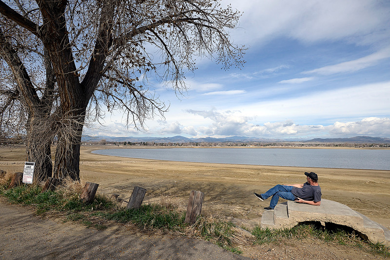 """Andrew Smith of Loveland relaxes in the sunshine on the east shore of Lake Loveland on Wednesday, April 17, 2019, in Loveland. Smith said """"I'm just doing a little praying.""""  (Photo by Jenny Sparks/Loveland Reporter-Herald)"""