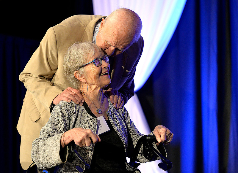 Lynn Hammond gives his wife, Norma Hammond a kiss on the forehead on Thursday, May 2, 2019, after arriving to the ballroom at Embassy Suites Hotel and Conference Center in Loveland for the 2019 Foundation of Northern Colorado Celebration of Philanthropy. The Hammonds received the Founder's Award during the event.  MAIN PHOTO (Photo by Jenny Sparks/Loveland Reporter-Herald)