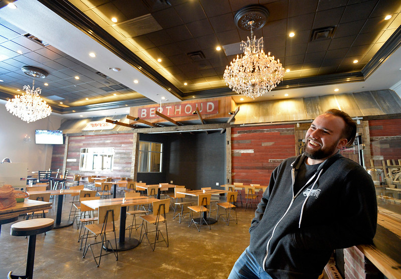 Jesse Sommers, co-owner of the new 5030 Local restaurant and brewery in west Loveland, sits in the tap room Friday, Feb. 8, 2019, which is housed in the former Fountains of Loveland building. They kept some of the elements like the chandeliers and added some rustic touches as well. The Berthoud Brewing Co., teamed up with Peel Handcrafted Pizza in Frederick, to create 5030 Local. (Photo by Jenny Sparks/Loveland Reporter-Herald)
