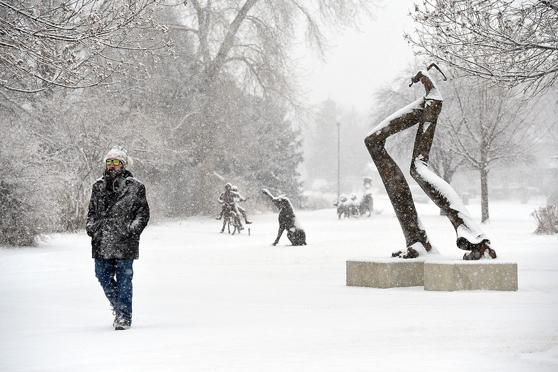 Chris Eagan walks in the frosty snow Wednesday, Feb. 6, 2019,  at Benson Sculpture Garden in Loveland. Eagan said he usually walks for a couple of hours while his son is in preschool.  (Photo by Jenny Sparks/Loveland Reporter-Herald)