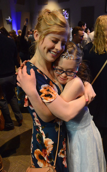 Miranda Lambert, left, gets a hug from her sister, Grace Hill, after crowning her queen of the prom Friday night, Feb. 8, 2019, during Night to Shine at Foundations Church in Loveland. (Photo by Craig Young / Loveland Reporter-Herald)
