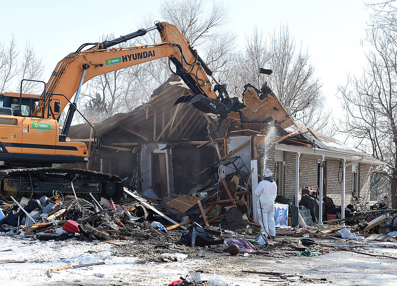 A crew demolishes a house at 860 4th St. SE on Monday, Feb. 11, 2019, in unicorporated Loveland. Larimer County deemed the property to be a threat to public safety because of code violations including hazardous levels of methamphetamines. The Larimer County Sheriff's Department served a search warrant and area SWAT teams removed nomerous peolpe from the house before demolition crews began their work.  (Photo by Jenny Sparks/Loveland Reporter-Herald)