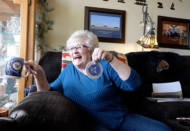 Sitting in her Loveland apartment, U.S. Navy veteran Gloria Atteberry proudly shows off her U.S. Navy coffee cup and coaster as she talks Monday, Feb. 25, 2019, about her service and her trip on the last honor flight out of Loveland to Washington D.C.   (Photo by Jenny Sparks/Loveland Reporter-Herald)