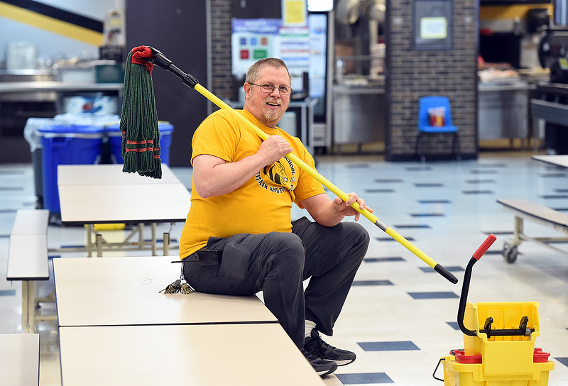 Paul Kirkland, custodian at Walt Clark Middle School, poses for a portrait in the cafeteria on Wednesday, March 6, 2019, at the school in Loveland.  (Photo by Jenny Sparks/Loveland Reporter-Herald)