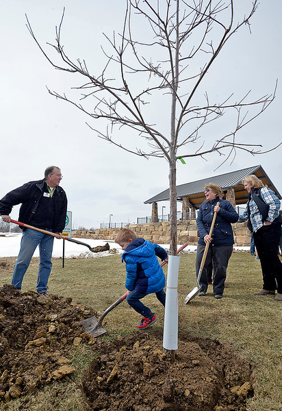Sonja Mehaffey, right, Jodi Shadduck-McNally, far right, and Loveland City Manager Steve Adams, left, share a laugh as Mehaffey's great grandson, Mikey Donnelly, 5, helps plant a tree on Friday, April 12, 2019, during an Arbor Day ceremony at the park in west Loveland. Sonja and Ray Mehaffey sold their farm land to the city where they built Mehaffey Park. In honor of Arbor Day and the city's 30th year being designated as a Tree City USA by The Arbor Day Foundation for the 30th year, city crews planted 29 trees in the park this week and people who attended the ceremony helped plant the 30th tree, a Buckley Oak. They planted 30 different species of trees. (Photo by Jenny Sparks/Loveland Reporter-Herald)