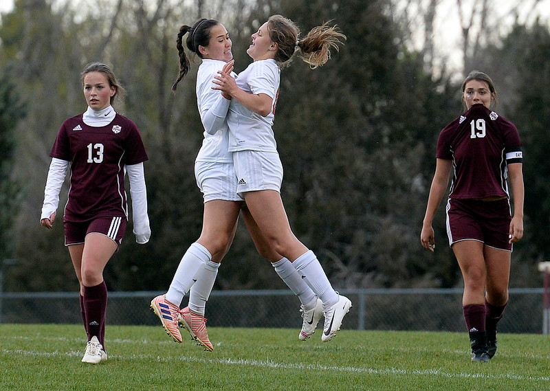 Loveland's Megan Stackhouse, left, and Riley Hall celebrate after Stackhouse scored during their game against Berthoud on Thursday, May 1, 2019, at Berthoud High School.   (Photo by Jenny Sparks/Loveland Reporter-Herald)