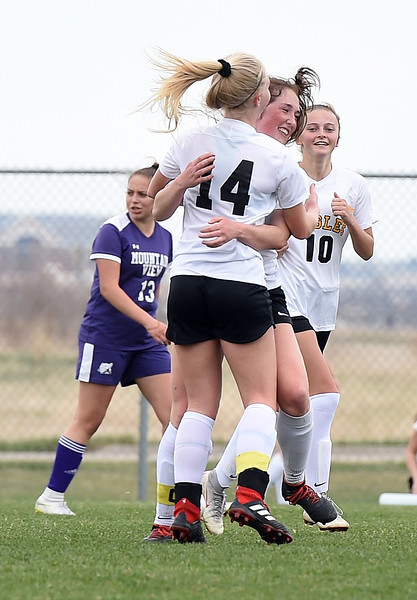 Thompson Valley's Novi Briggs celebrates with teammates after scoring during their game against Mountain View Tuesday, April 16, 2019, at Mountain View in Loveland.  (Photo by Jenny Sparks/Loveland Reporter-Herald)