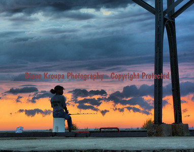 Little fisher girl on breakwater at South Haven Light at sunset. Photo #F500