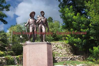 Tom Sawyer and Huck Finn statue near cave, Hannibal, MO.  Photo# 2015-100