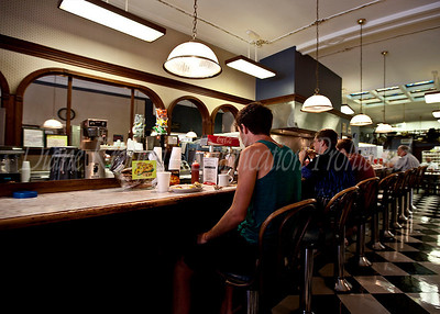 The cane back stools at the lunch counter were never empty for long as there was a constant stream of customers arriving to  savor the old time flavors.  Photo #127