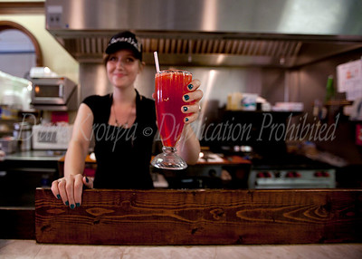 This pretty gal is serving me a hand squeezed lemonade with cherry flavoring at the soda fountain and lunch counter of The Corner Pharmacy.  - WOW what a fantastic drink that was - just doesn't get any better than that.   This pharmacy has been at this location for over 130 years.  The present pharmacist and owner, Ron Booth bought the pharmacy in 1980 and restored the store with meticulous attention to detail and authenticity.  The food is as good as it gets and visiting this nostalgic store was a trip down memory lane for me.  I  hope to return again soon and try their signature, old time flavor hamburgers or hot dogs.  Photo #174