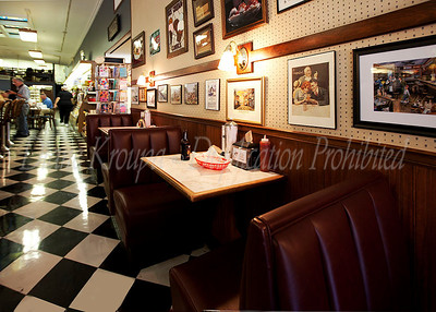 The cozy booths along the wall opposite the lunch counter had deep red upholstery and provided a meassure of  privacy to the diners.   Lots of nostalgic memories covered the walls.  Photo #152