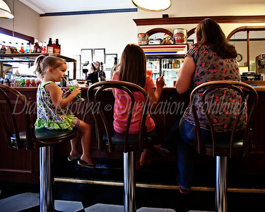 Sipping green lemonade - memories are made of this at The Corner Pharmacy, Leavenworth, Kansas.  Photo #133