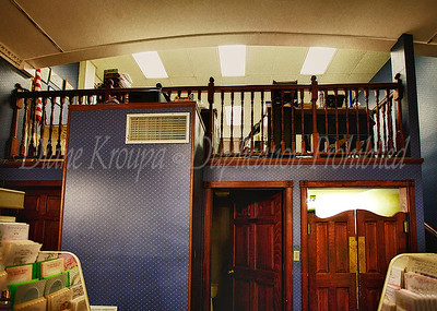 This is a close up of the loft area to the rear of the fountain and lunch counter at The Corner Pharmacy.  Photo #118