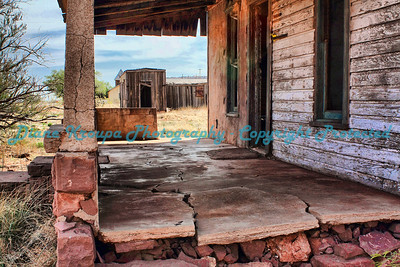 This old homestead was along Route 66 in Cuervo, New Mexico.  The view through the front patio frames a boxcar home so typical of that era.  Photo #MR666