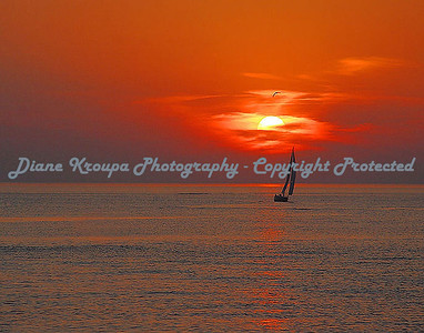 Red Sails in the sunset on Lake Michigan at South Haven, Michigan.  Photo #1010