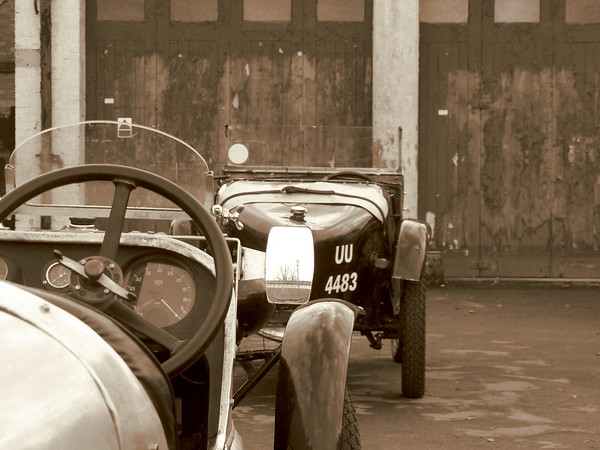 Austin 7 sits outside old garage door