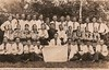 """Товариство """"Луг"""", с. Іване-Золоте, 1937 рік.  В центрі другог ряду сидять 5-й зліва Кінащук Василь, 6-й зліва Юрчишин Іван, 7-й - Гандзюк Іван."""