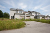 A tract of new housing sits abandoned and unfinished in upstate NY.