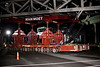 A pedestrian bridge is moved into place the night of Oct 15, 2012, on the Silver Line in Tysons, Va.