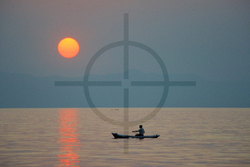 Paddling home at sunset, Lake Malawi, Malawi