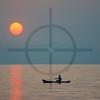 Paddling home at sunset, Lake Malawi, Malawi