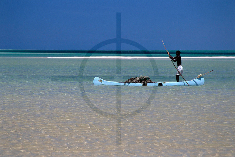 Poling fisherman at low tide, Magaruque Island, Bazaruto Archipelago, Mozambique