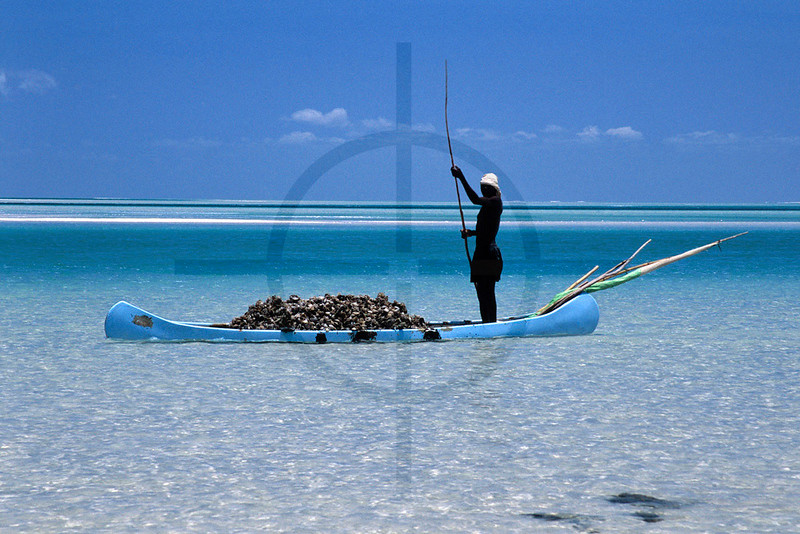 Poling fisherman at low tide, Magaruque Island, Bazaruto Archipelago, Mozambique
